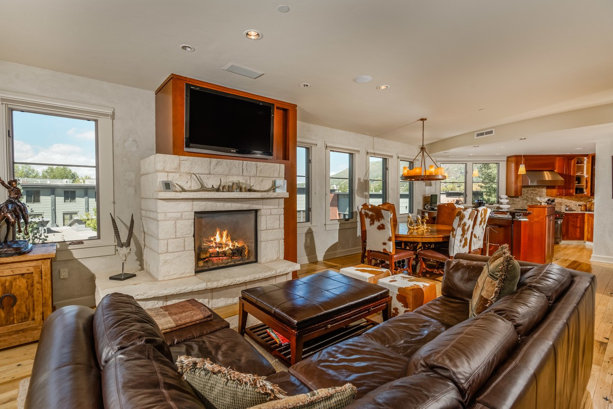 Living area with fireplace at Obermeyer 101 Penthouse Condo for Rent