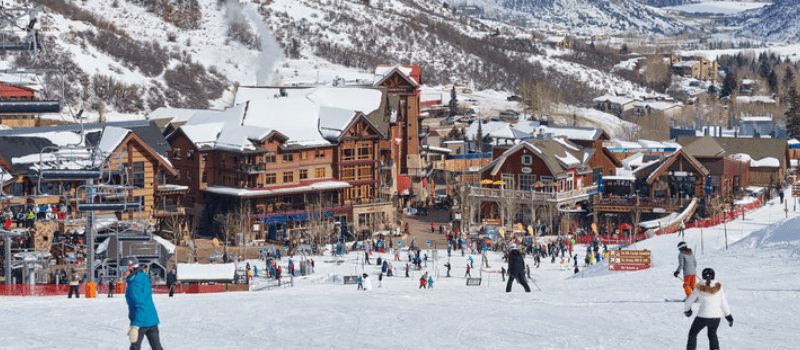 Snowmass ski area with condos on a snowy day